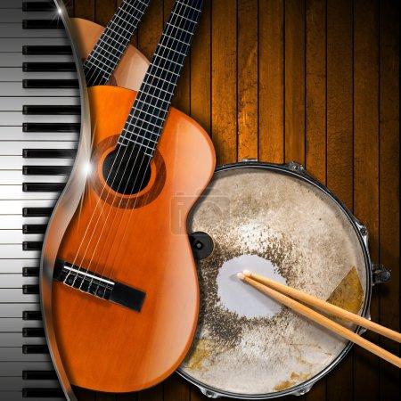 Photo pour Deux guitares acoustiques, clavier piano et caisse claire métallique sur fond de bois rustique. Concept de performance musicale - image libre de droit