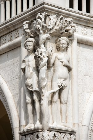 Detail of the Doge Palace with statues of Adam and...