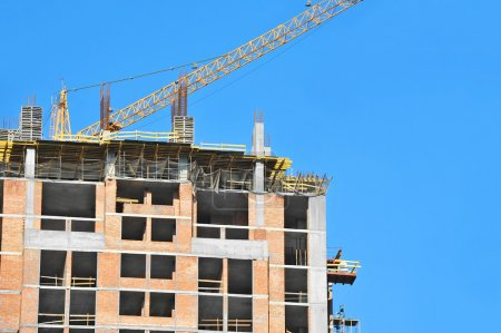Building crane and building under construction aga...