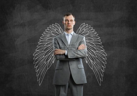 Young businessman with wings