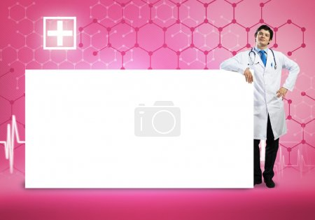 Doctor with blank banner