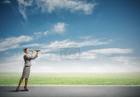 woman looking in spyglass