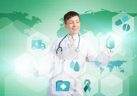 Photo for Young woman doctor touching icons of media screen - Royalty Free Image