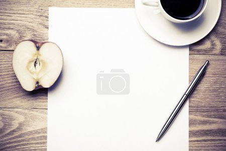 Photo for White blank paper with cup of coffee on wooden table - Royalty Free Image