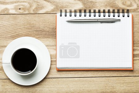 blank notepad with cup of coffee
