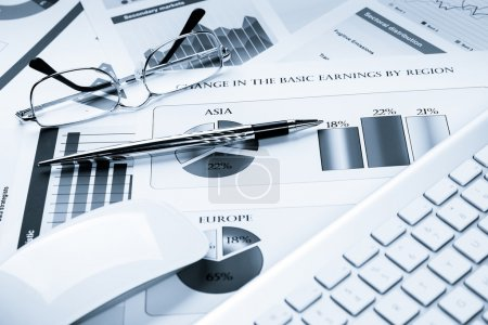 Business workplace with financial documents