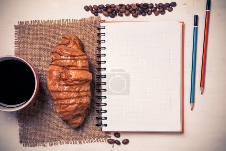 notepad and cup of coffee