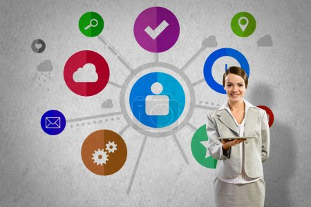 Businesswoman presenting tablet pc and color icons