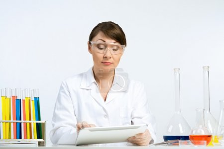 female scientist making test