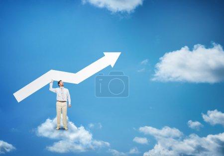 businessman  on cloud with arrow