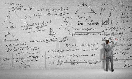 man drawing formulas