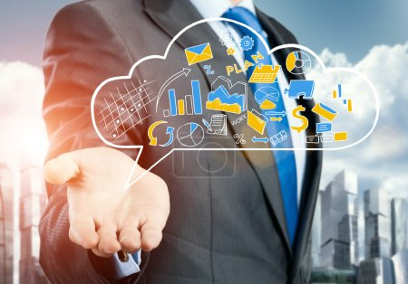 businessman showing cloud with business sketches