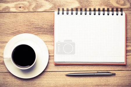 blank with cup of coffee and pen