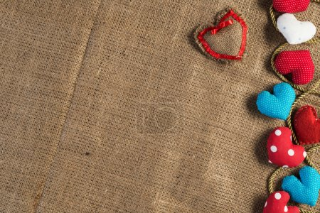 Handmade love hearts on brown clothing