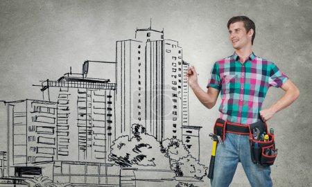 Guy engineer sketching his ideas