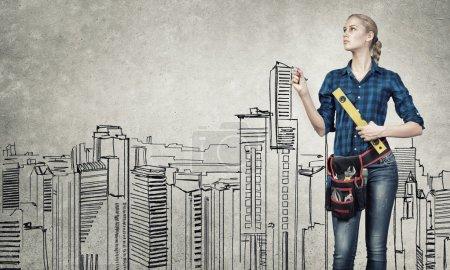 Woman engineer sketching her ideas