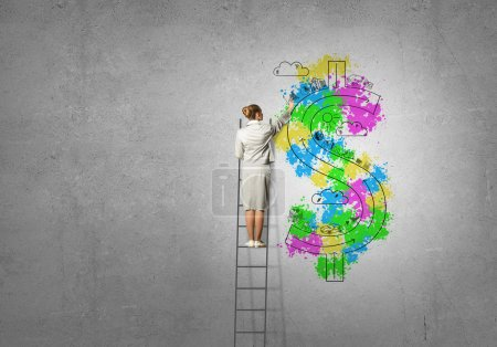 Photo for Back view of businesswoman standing on ladder and drawing on wall - Royalty Free Image