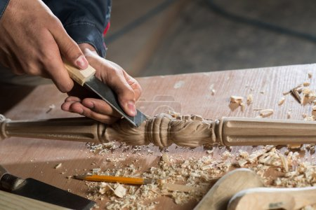 Photo for Close up carpenter's hands that work with cutter - Royalty Free Image