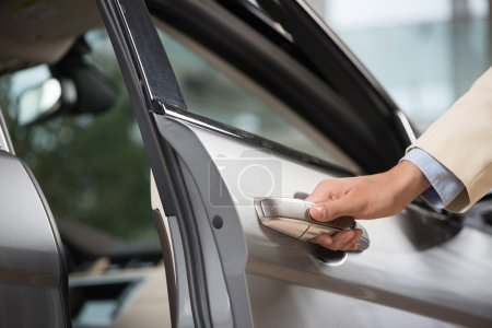 Photo for Close up of human male hand opening car door - Royalty Free Image