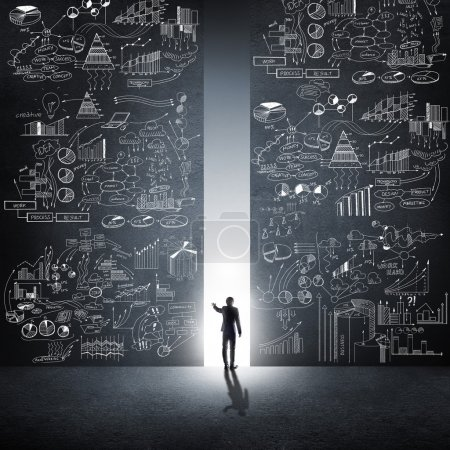 Photo pour Rear view of businessman standing in light of way. Facing new opportunities - image libre de droit
