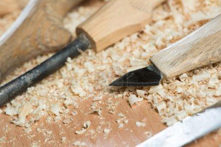Carpenter's tools lying among sawdust