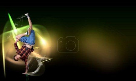 Breakdancer standing on hand