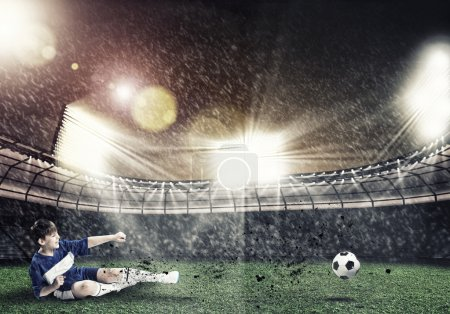 Boy football player at stadium