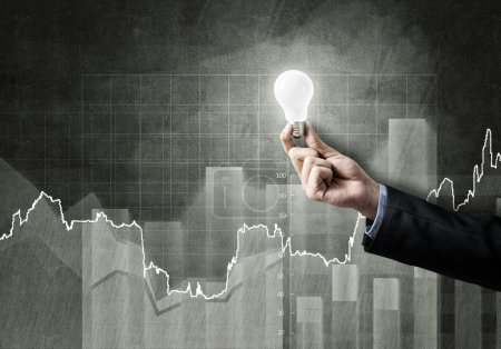 Photo for Conceptual image with light bulb diagrams and graphs - Royalty Free Image