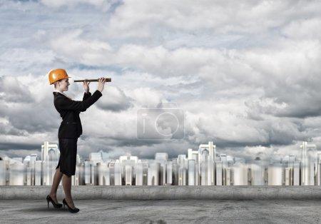 Woman engineer looking in spy glass