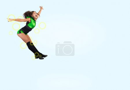 Cheerleader girl jumping high