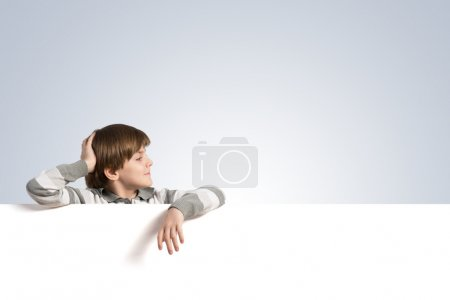 Boy with blank advertising board