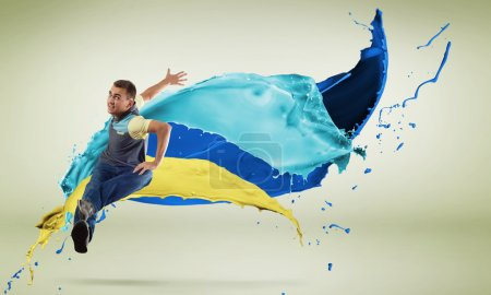 Photo for Modern style dancer in jump and color paint splashes at background - Royalty Free Image