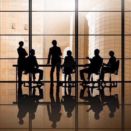 Businessteam sitting round table