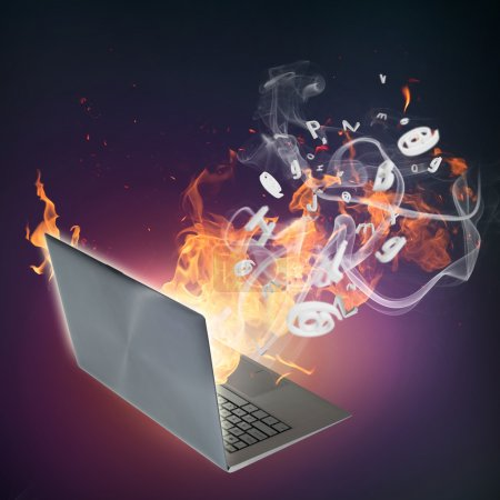Laptop burning in flames