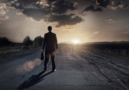 Photo for Businessman goes straight on his way on asphalt road to success - Royalty Free Image