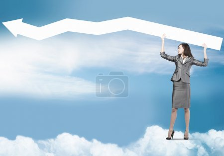 Businesswoman with arrow on cloud