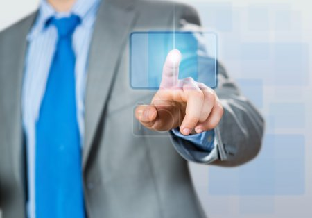 businessman hand touching icon