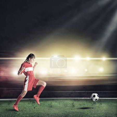 Female footballer with ball