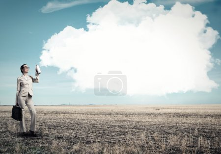 Photo for Young businesswoman with suitcase using spray balloon - Royalty Free Image