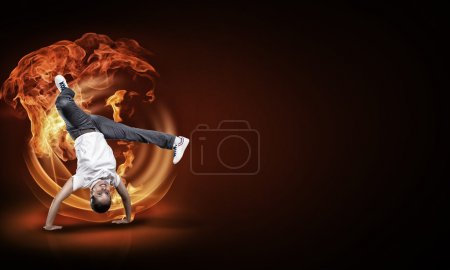 Photo for Young girl hip hop dancer with fire effect at background - Royalty Free Image