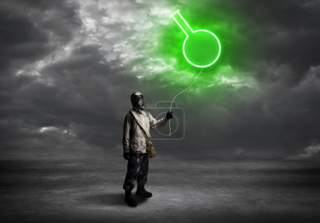 Man in respirator with balloon