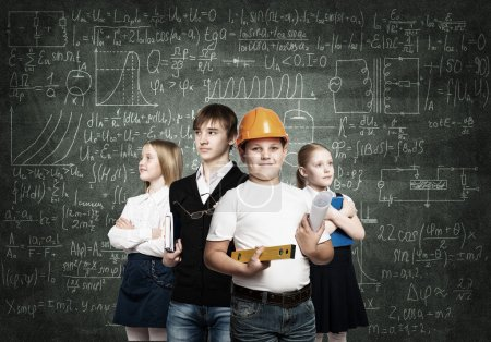 Photo for Children of school age trying different professions - Royalty Free Image