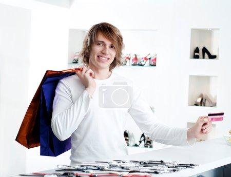 Man at shopping checkout paying