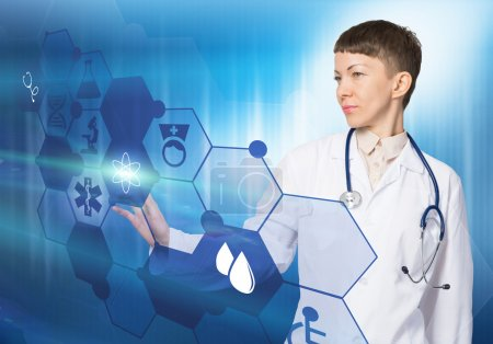 Photo for Young woman doctor touching icon of media screen - Royalty Free Image