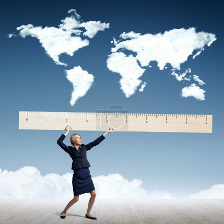 businesswoman measuring world map