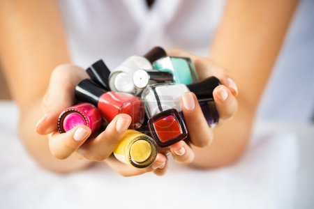 woman hands with nail polishes