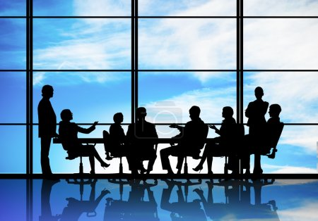 businesspeople  sitting round table