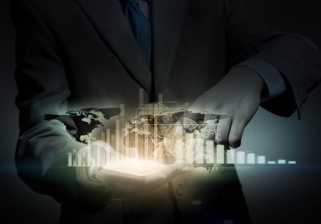 businessman holding virtual graph