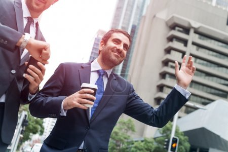 Businessmen stopping car
