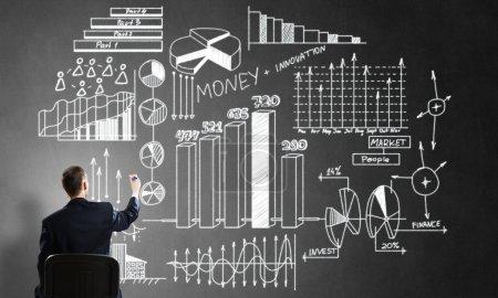 businessman sketching infographs